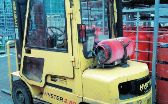 Forklift truck showing propane tank.